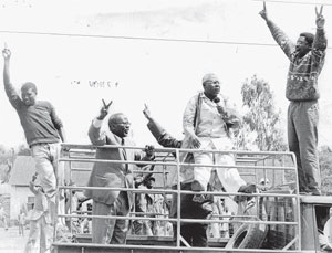 Martin Shikuku, with microphone, James Orengo, with hands up and the late Masinde Muliro, as they tried to storm Kamukunji for a banned rally.